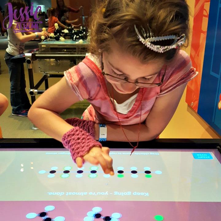Kyla playing at Liberty Science Center