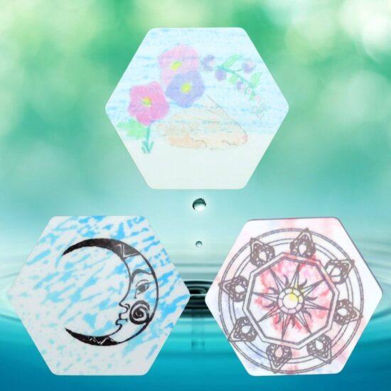 three hexagon magnets on aqua background