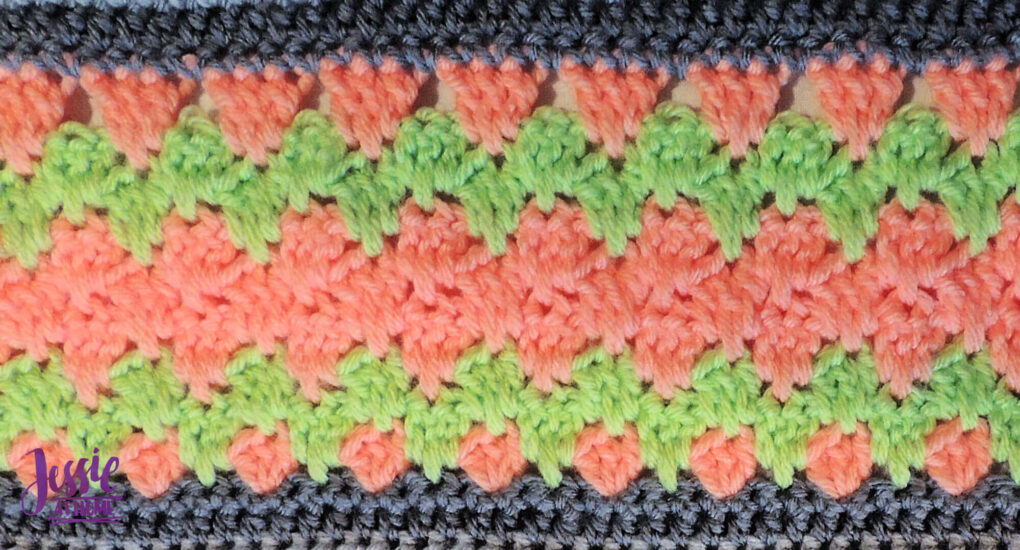 Salmon and light green crochet stitch pattern with gray on top and bottom.