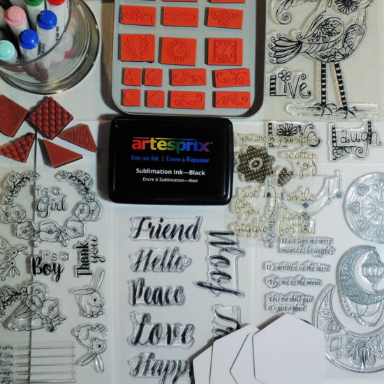 Flay lay photo if many stamps and an ink pad