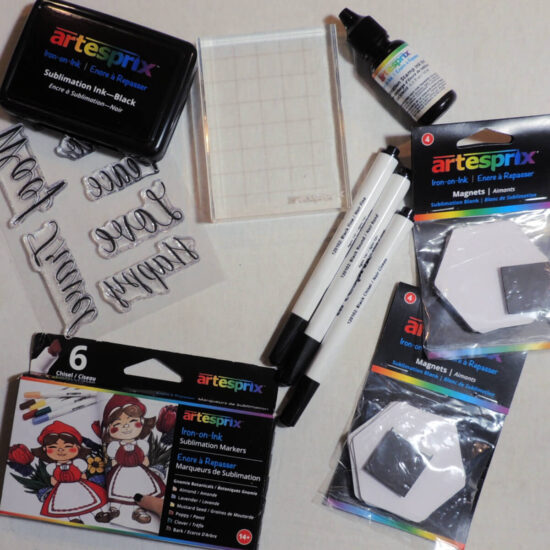flat lay photo of markers, stamps, ink pad, stamp block, and hexagon magnate blanks