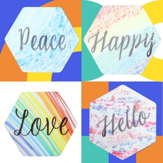 """Four hexagon magnets that say """"Love"""", """"Hello"""", """"Peace"""" & """"Happy"""", all on a colorful background"""