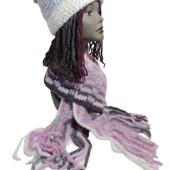 Image of a pink and gray fluffy scarf and a purple and white stocking hat with a folded up brim on a mannequin head.